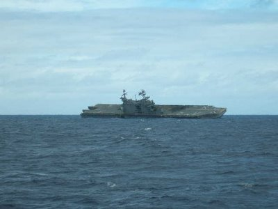 USS Belleau Wood begins to list
